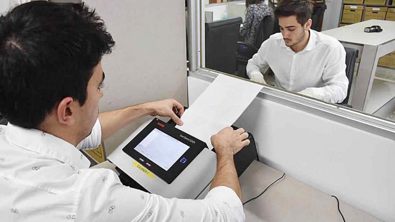 Proceso de digitalización de la documentación que esta en papel. (Municipalidad de Córdoba)