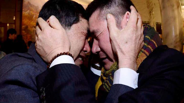 ENCUENTRO. En 2014, de dos hermanos (Park Hee-soo/Korea Pool Photo vía AP/Archivo).
