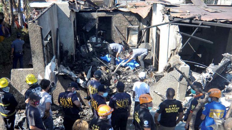 FILIPINAS. Tragedia en una zona residencial (AP).