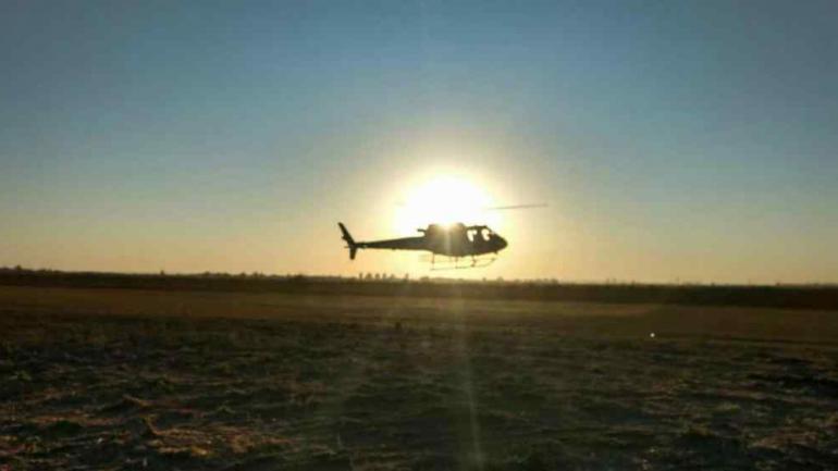 Helicópteros del Plan Provincial de Manejo del Fuego trabajan en Totoral.