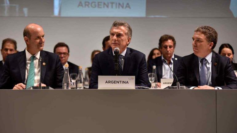 El presidente del Banco Central, Federico Sturzenegger, Macri y el ministro de Hacienda, Nicolás Dujovne (Presidencia).
