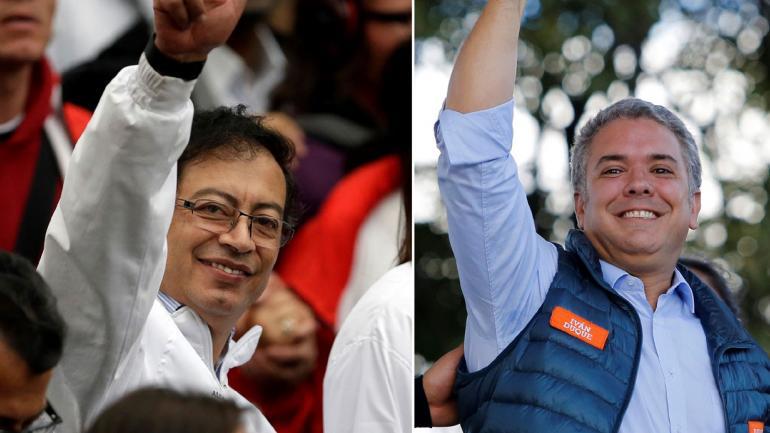 PETRO Y DUQUE. Los candidatos a la segunda vuelta (AP).