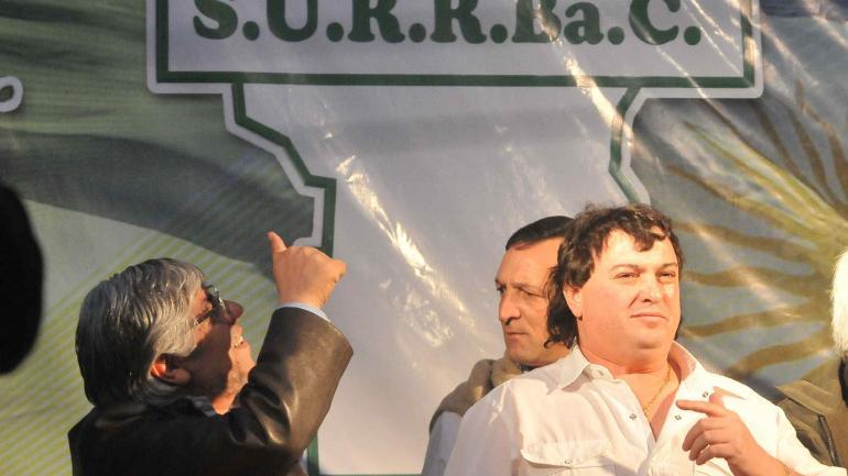 EXAMIGOS. Hugo Moyano y Mauricio Saillén, en un acto en el Surrbac en 2010, antes de la pelea. (Darío Galiano / archivo)